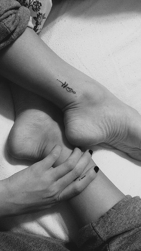 Small Ankle Unalome Tattoo