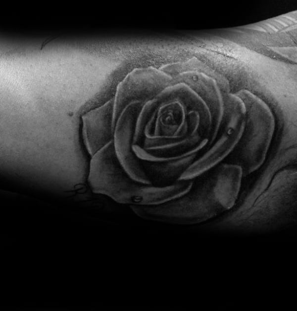 Small Bicep Realistic Grey And Black Shaded Rose Flower Mens Tattoos