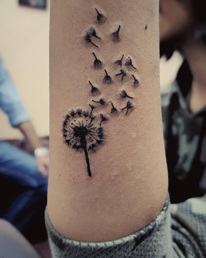 small black and grey dandelion tattoo