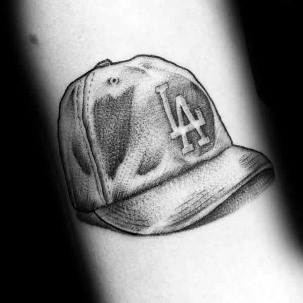 Small Black And Grey Shaded Mlb Baseball Hat Dodgers Male Tattoo Ideas
