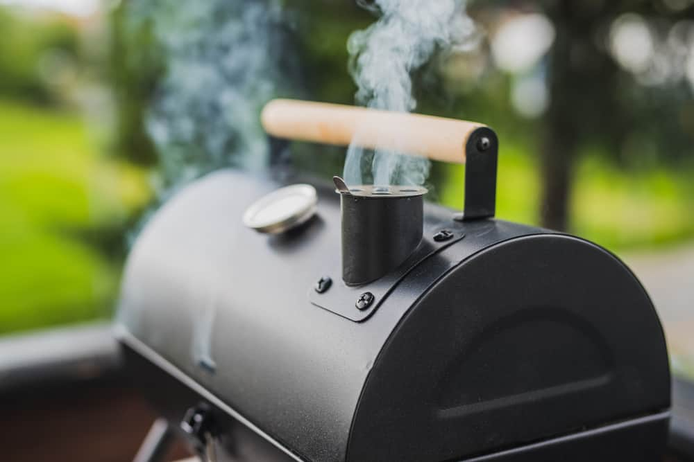 smoke coming out from small black smoker