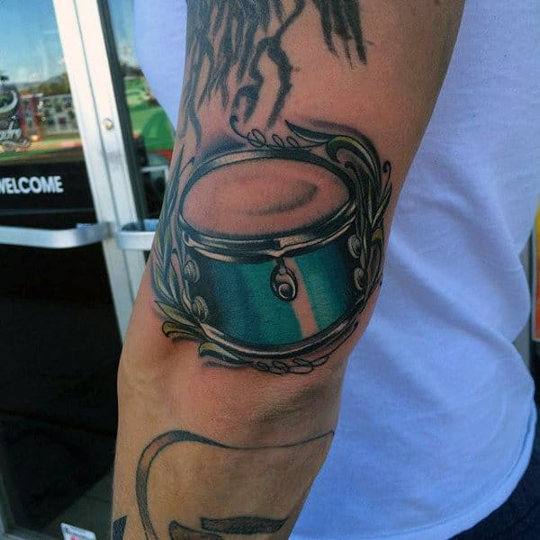 Small Blue Drum Mens Tricep Tattoo Ideas
