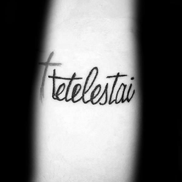 Small Cross With Tetelestai Script Male Forearm Tattoo Inspiraton