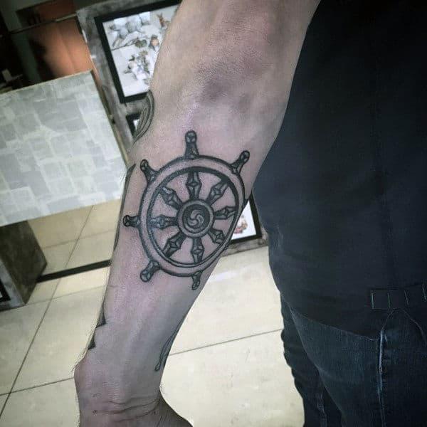 Small Dharma Wheel Outer Forearm Tattoo On Man