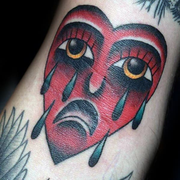 Small Dtich Red Ink Traditional Crying Heart Mens Tattoo Ideas