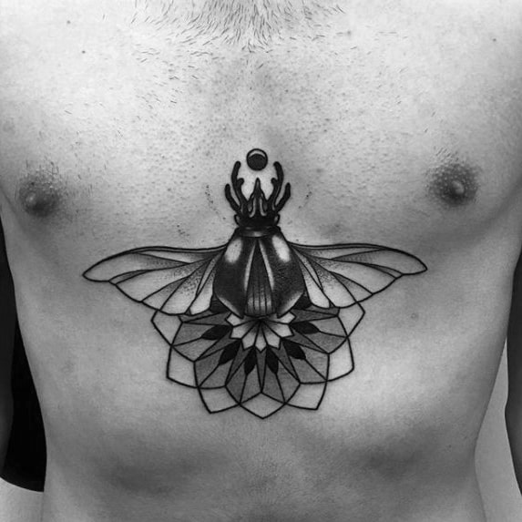 small geometric flower scarab bettle mens center of chest tattoo