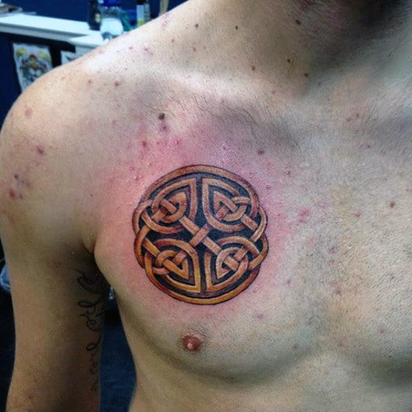 Small Guys Celtic Knot Shield Tattoo On Upper Chest