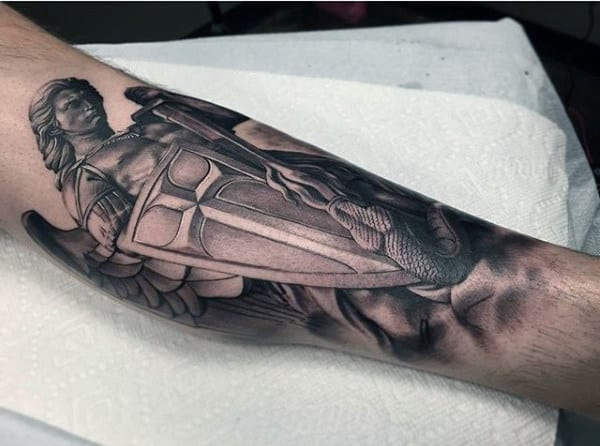Small Guy's Tattoo Of Saint Michael With Shield