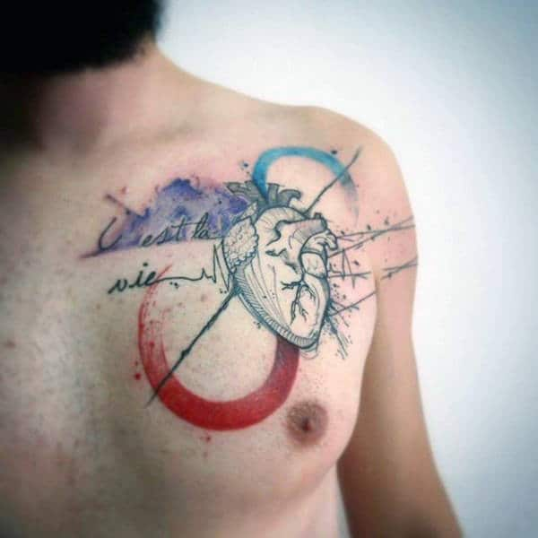 Small Heart Watercolor Tattoo On Chest For Guys
