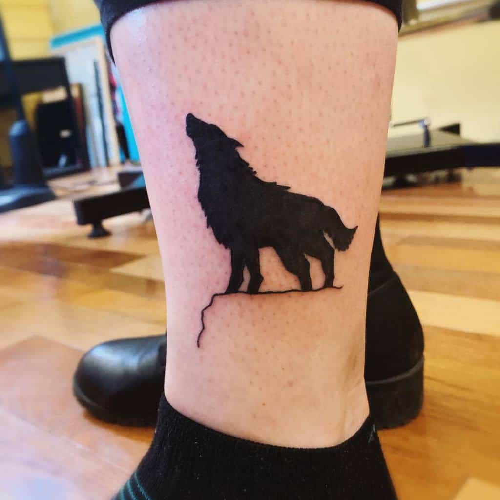 small howling wolf tattoo brihaug