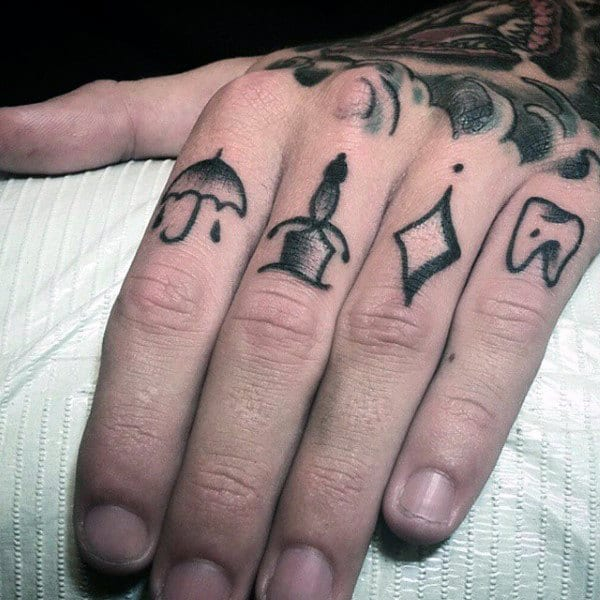 Small Knuckle Tattoo Symbols On Man
