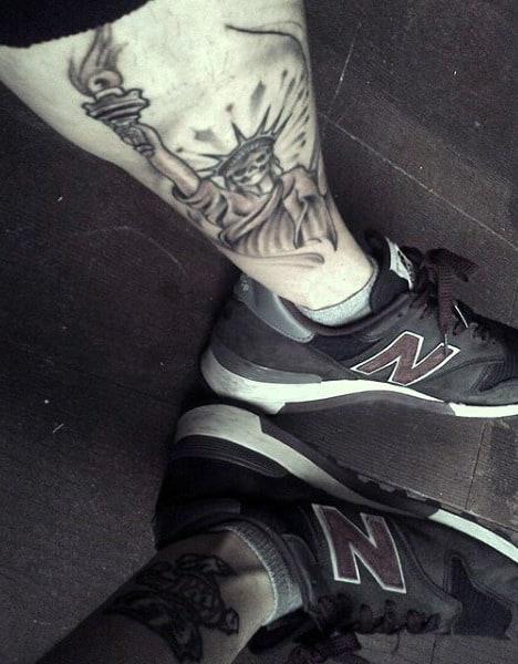 Small Lady Liberty Leg Tattoo For Men