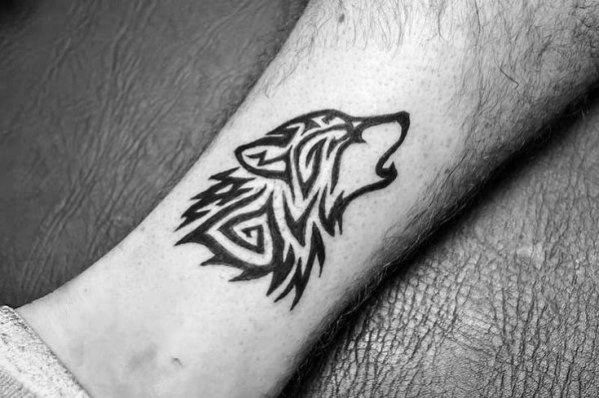 Small Leg Wolf Animal Tribal Tattoo Design Ideas For Males
