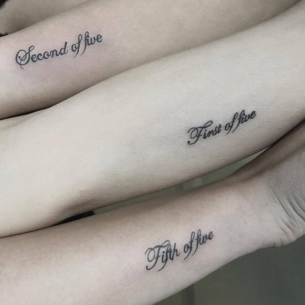 small-lettering-black-and-white-sister-tattoo-tattoorilla