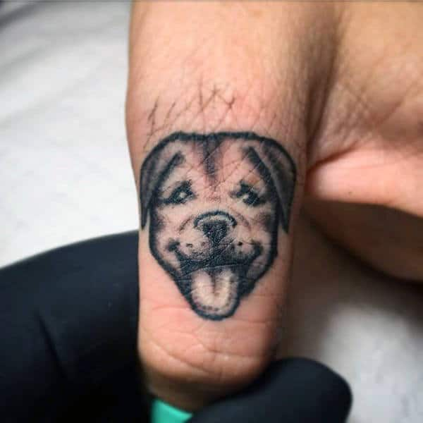 Small Mens Dog Tattoo On Finger