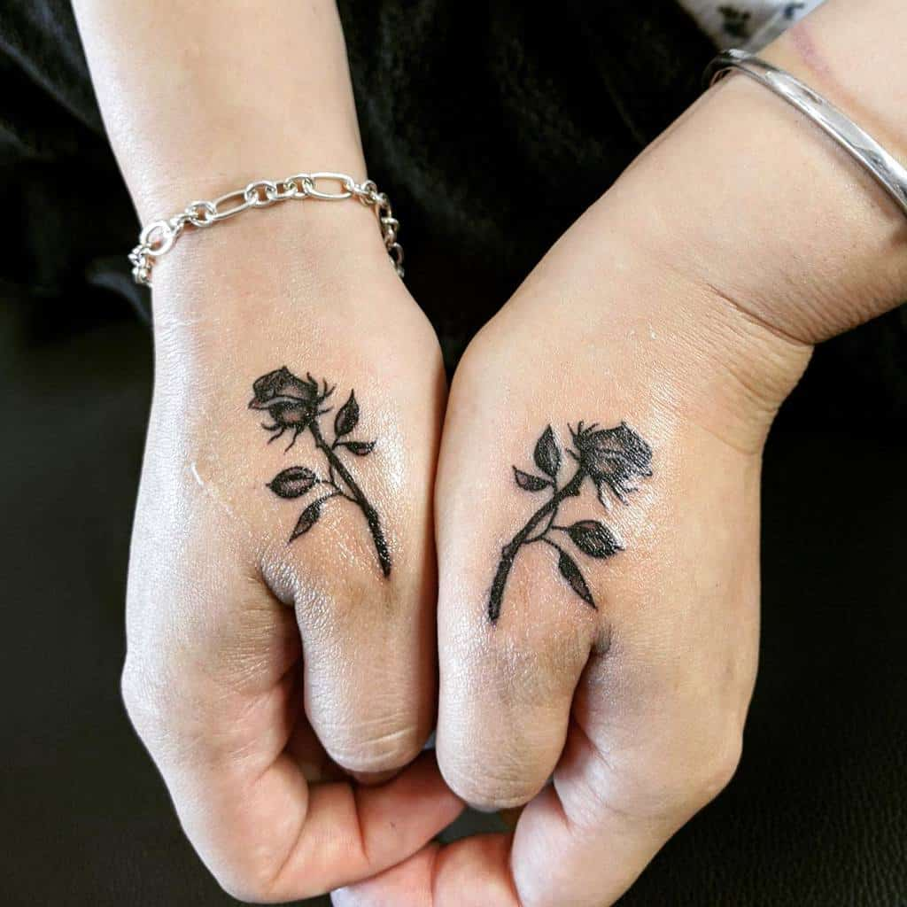 small minimalist rose hand tattoos thelaughingbuddhatattoo
