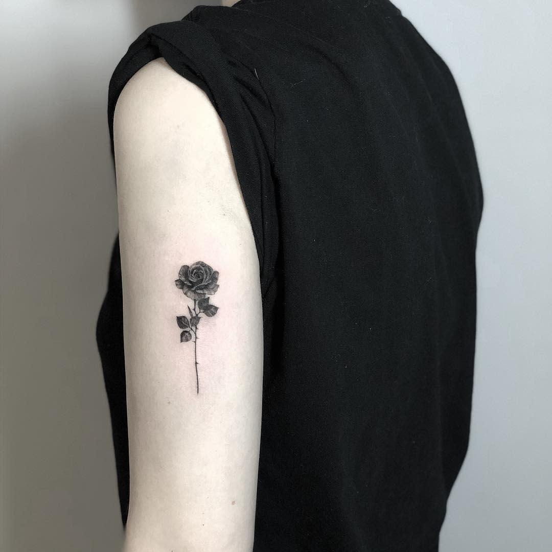 small minimalist rose with stem tattoos danitattoonyc