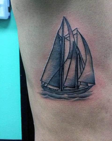 Small Ribs Mens Sailboat At Sea Tattoo