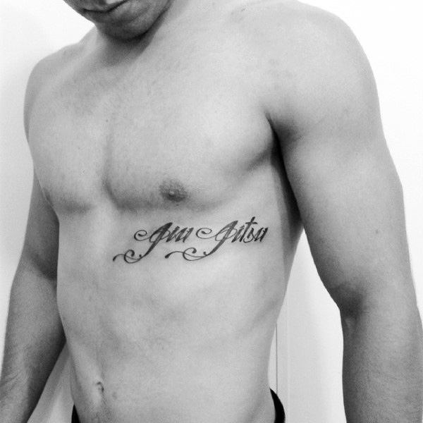 Small Script Jiu Jitsu Guys Rib Cage Tattoo