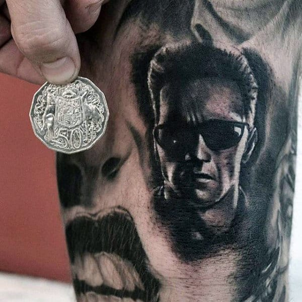 Small Shaded Guys Terminator Arm Tattoo