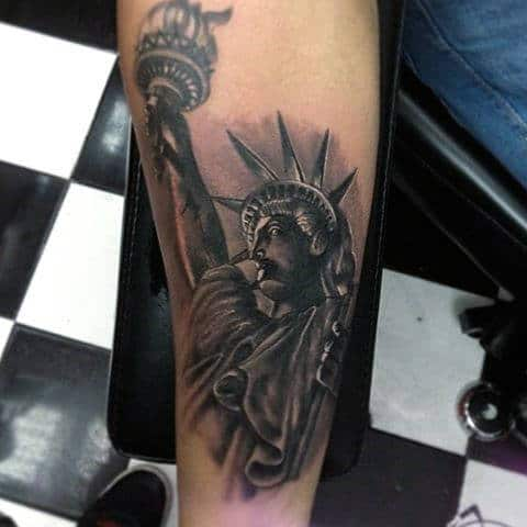 Small Shaded Statue Of Liberty Mens Tattoo On Forearm