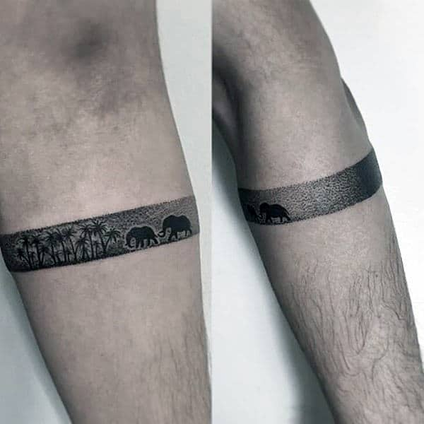 Small Simple Amband Tattoo On Male With Elephants And Palm Trees