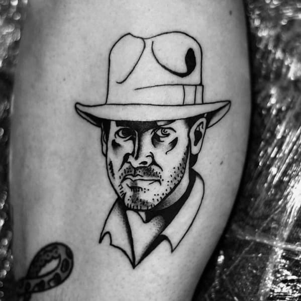 Small Simple Black Ink Indiana Jones Tattoo For Guys