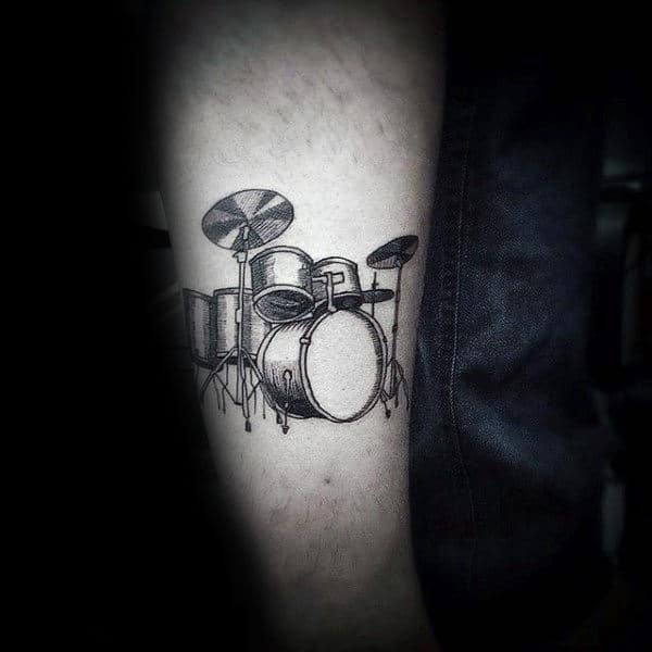 Small Simple Drums Leg Tattoo On Male