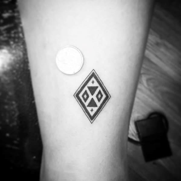 Small Simple Geometric Guys Tiny Back Of Leg Tattoo