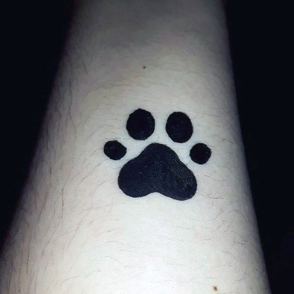 Small Simple Guys Dog Paw Solid Black Ink Forearm Tattoo