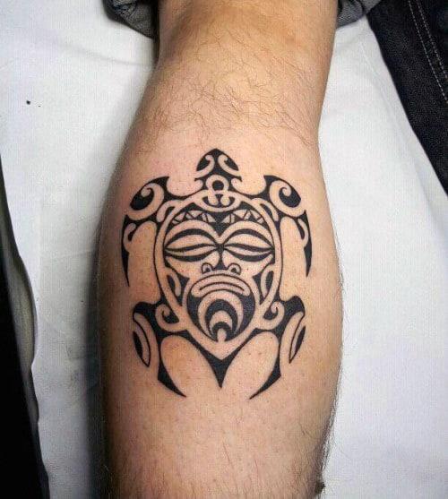 Small Simple Guys Face Turtle Tribal Leg Calf Tattoos