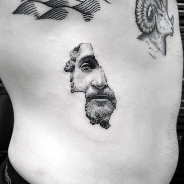 Small Simple Guys Portrait Tattoo On Chest With Cool Design