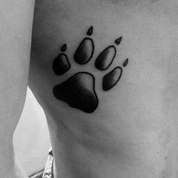 Small Simple Guys Shaded Old School Dog Paw Tattoo On Rib Cage Side