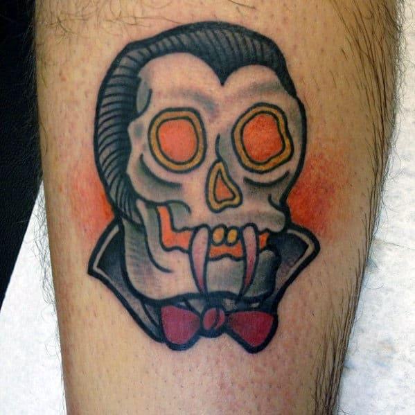 Small Simple Guys Traditional Dracula Vampire Fangs Tattoo On Leg