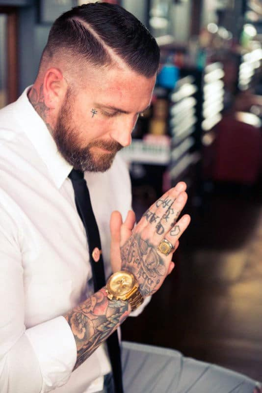 Small Simple Mens Face Cross Tattoos
