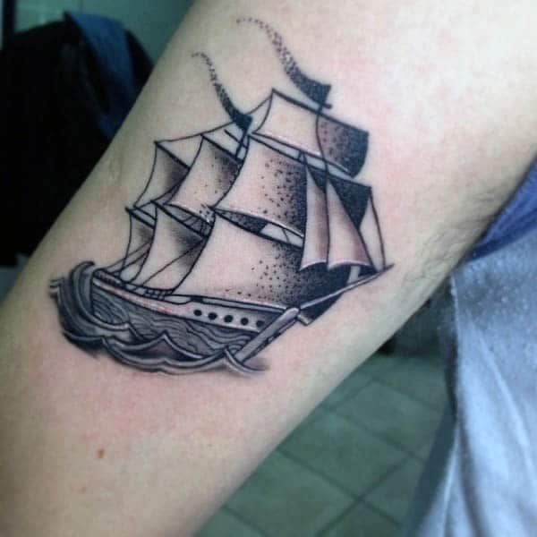 Small Simple Mens Tattoo Of Sailboat On Arm