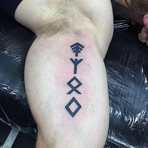 Small Simple Rune Bicep Tattoo On Guy