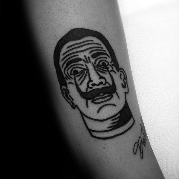 Small Simple Salvador Dali Tattoo Design On Man