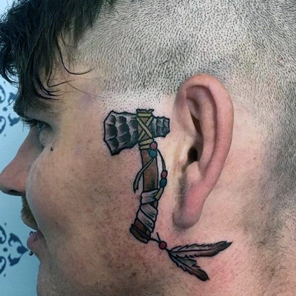 Small Simple Tomahawk Male Head Tattoo By The Ear