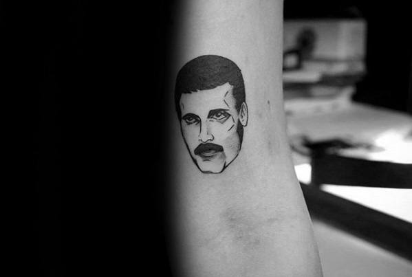 Small Simple Tricep Freddie Mercury Tattoo Designs For Guys