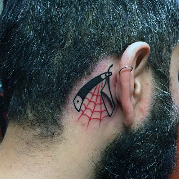 Small Straight Razor With Red Web Tattoo Guys Ear