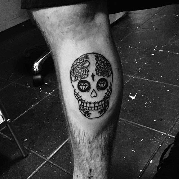 Small Sugar Skull Tattoo On Gentlemans Leg Calf With Black Ink