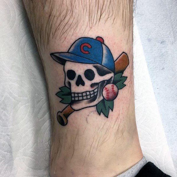 Small Traditional Skull Chicago Cubs Lower Leg Tattoo Design On Man