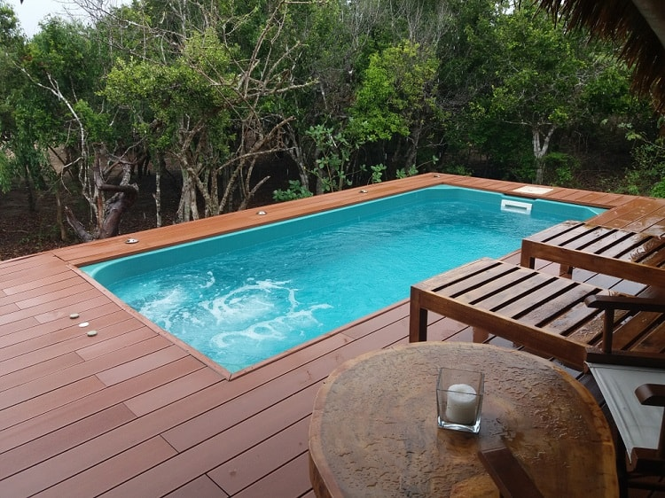 Small Tropical Composite Above Ground Pool Deck