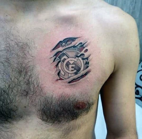 Small Upper Chest Ripped Skin Real Madrid Mens Tattoo Designs
