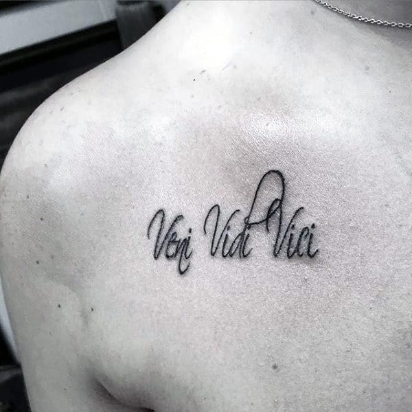 Small Veni Vidi Vici Upper Chest Tattoo On Gentleman