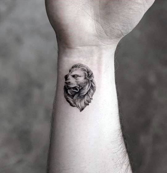 Small Wrist Guys Lion Statue Tattoo Design Ideas