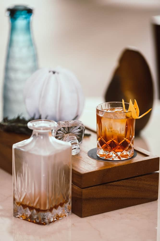 glass of smoked rum with ice cubes