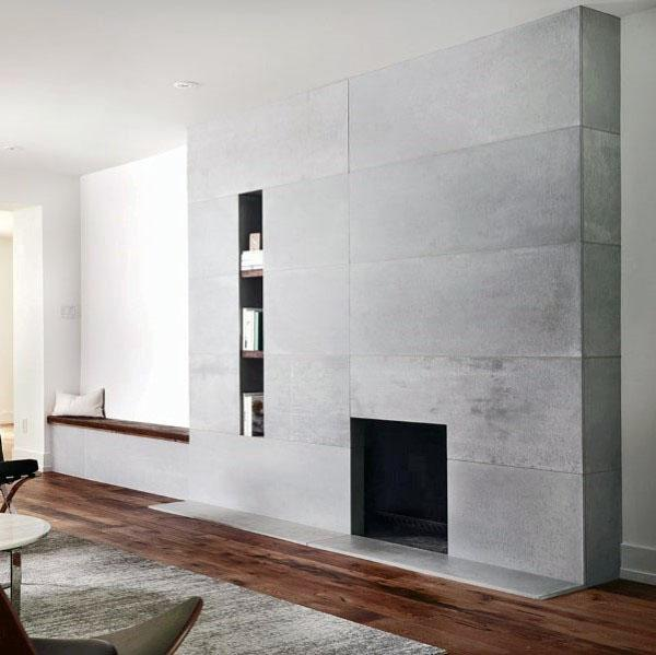 Smooth Grey Concrete Fireplace Design With Hardwood Floors