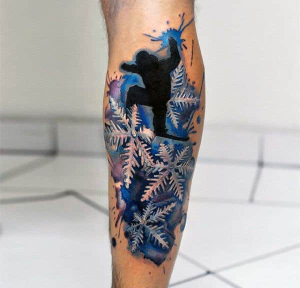 Snowboarding Snowflake Guys Back Of Leg Tattoo With Watercolor Blue Background Design